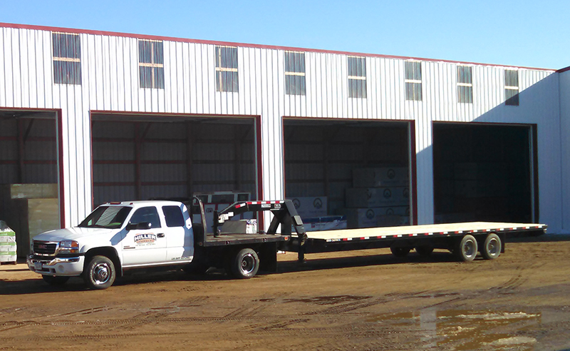 hiller lumber delivery truck with flatbed trailer